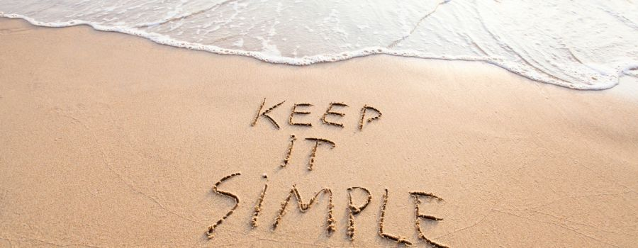 keep it simple written in the sand at the beach